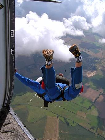 A skydiver jumping from a plane